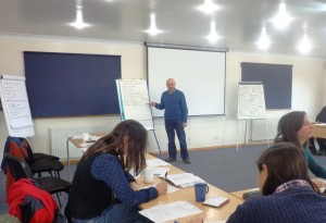JIM MCADAM (UKFIT) LEADING A SECTION OF THE CLIMATE CHANGE WORKSHOP IN STANLEY, 2014