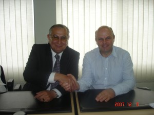 Jim McAdam signing a co-operation agreement with Dr Victor Fajardo, Rector, University of Magallanes.